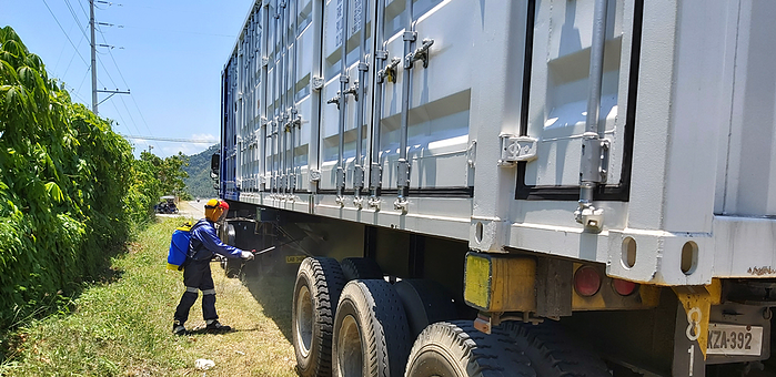 Disinfecting containers before entering energy stoarge project site in Southeast Asia