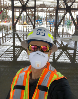 Fluence energy storage project manager wearing PPE onsite to protect from COVID19